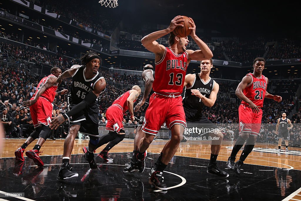<a gi-track='captionPersonalityLinkClicked' href=/galleries/search?phrase=Joakim+Noah&family=editorial&specificpeople=699038 ng-click='$event.stopPropagation()'>Joakim Noah</a> #13 of the Chicago Bulls grabs the rebound against the Brooklyn Nets in Game One of the Eastern Conference Quarterfinals during the 2013 NBA Playoffs on April 20 at the Barclays Center in the Brooklyn borough of New York City.