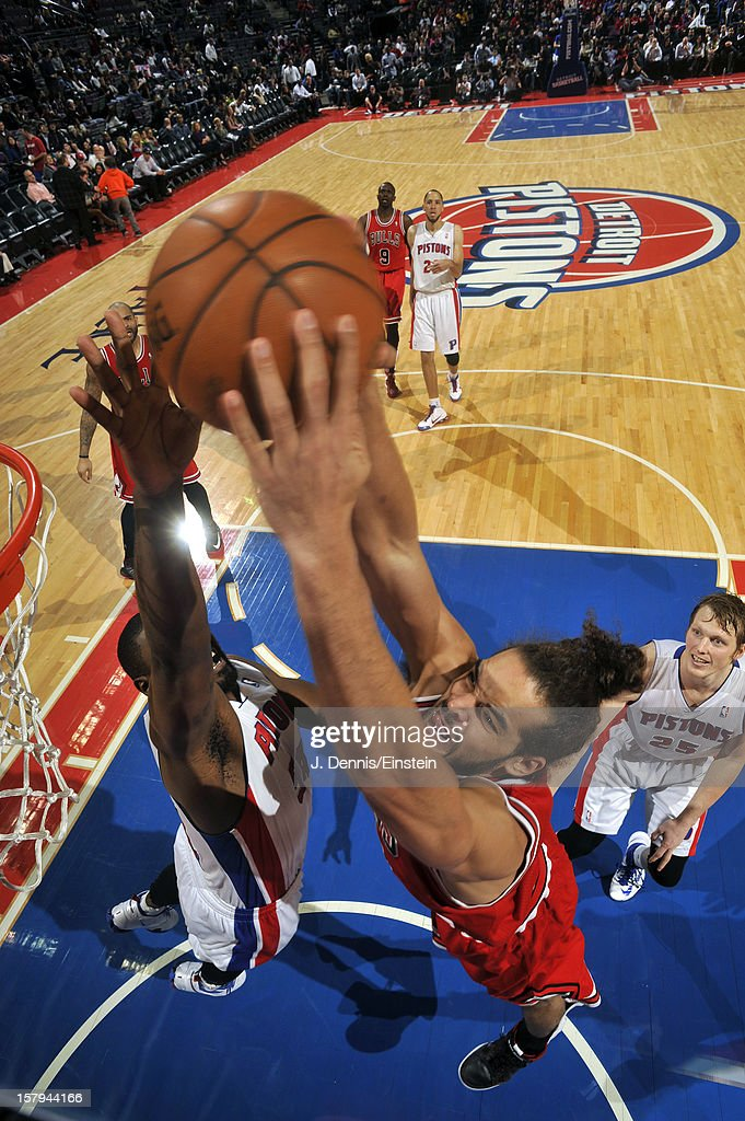 Joakim Noah #13 of the Chicago Bulls grabs the rebound against the Detroit Pistons on December 7, 2012 at The Palace of Auburn Hills in Auburn Hills, Michigan.