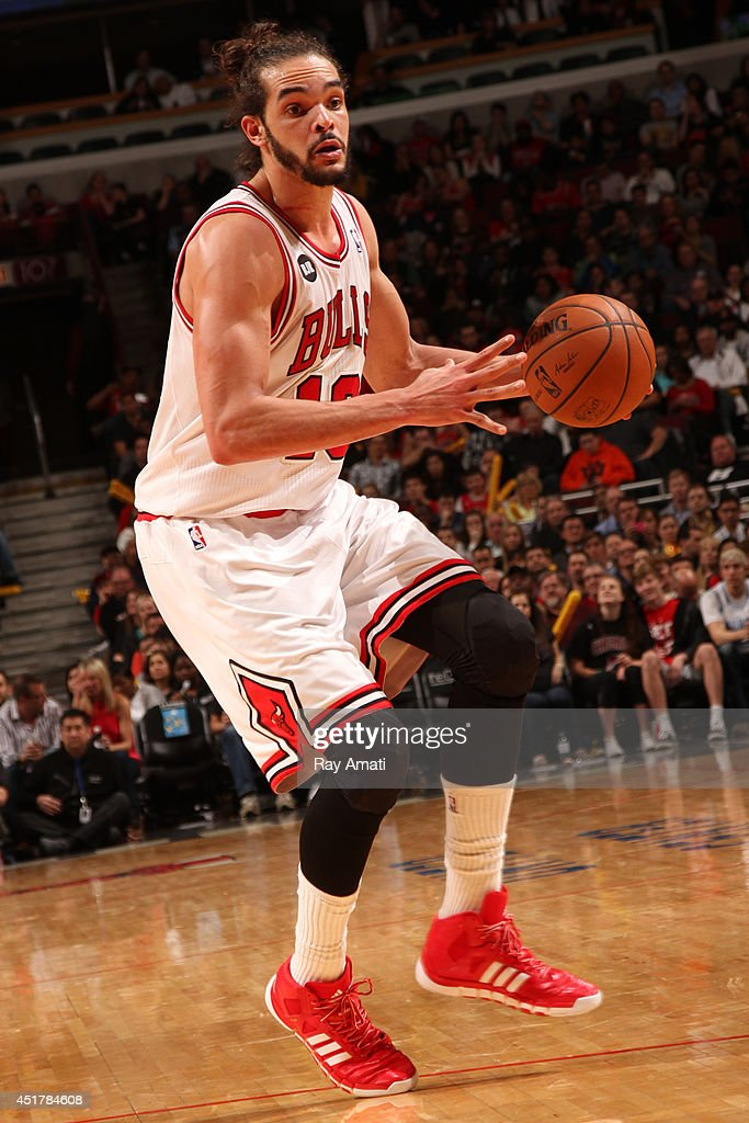 Joakim Noah #13 of the Chicago Bulls handles the ball against the Detroit Pistons on April 11, 2014 at the United Center in Chicago, Illinois.