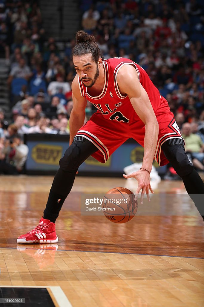 Joakim Noah #13 of the Chicago Bulls handles the ball against the Minnesota Timberwolves during the game on April 9, 2014 at Target Center in Minneapolis, Minnesota.