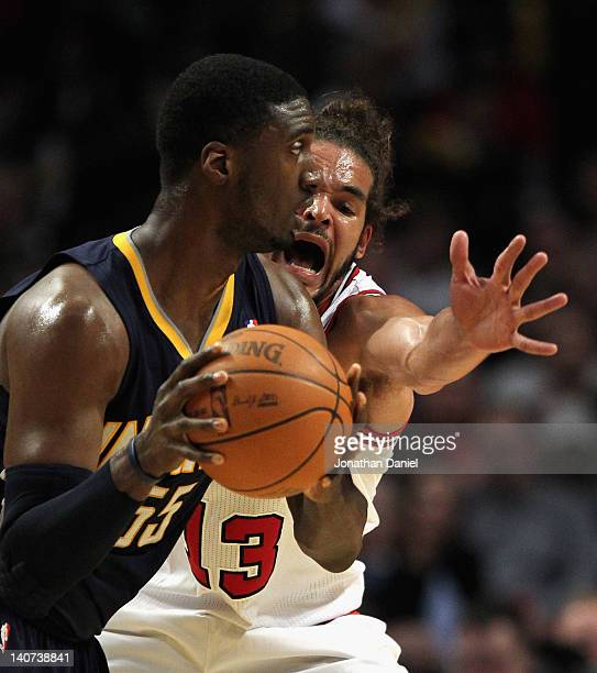 Joakim Noah of the Chicago Bulls harasses Roy Hibbert of the Indiana Pacers at the United Center on March 5 2012 in Chicago Illinois The Bulls...