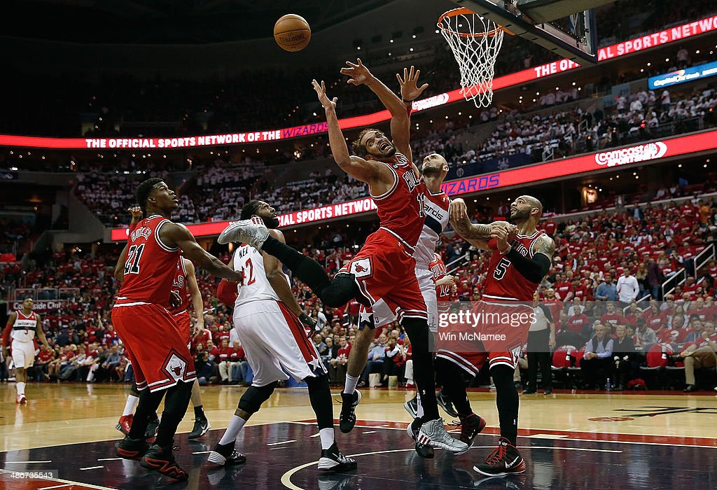 Joakim Noah #13 of the Chicago Bulls has his shot rejected by Marcin Gortat #4 of the Washington Wizards in first quarter action of Game 3 of the Eastern Conference Quarterfinals during the 2014 NBA Playoffs at the Verizon Center on April 25, 2014 in Washington, DC.