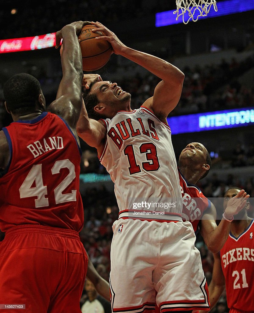 <a gi-track='captionPersonalityLinkClicked' href=/galleries/search?phrase=Joakim+Noah&family=editorial&specificpeople=699038 ng-click='$event.stopPropagation()'>Joakim Noah</a> #13 of the Chicago Bulls is fouled by <a gi-track='captionPersonalityLinkClicked' href=/galleries/search?phrase=Evan+Turner&family=editorial&specificpeople=4665764 ng-click='$event.stopPropagation()'>Evan Turner</a> #12 of the Philadelphia 76ers as <a gi-track='captionPersonalityLinkClicked' href=/galleries/search?phrase=Elton+Brand&family=editorial&specificpeople=201501 ng-click='$event.stopPropagation()'>Elton Brand</a> #42 gets his hand on the ball in Game One of the Eastern Conference Quarterfinals during the 2012 NBA Playoffs at the United Center on April 28, 2012 in Chicago, Illinois. The Bulls defeated the 76ers 103-91.