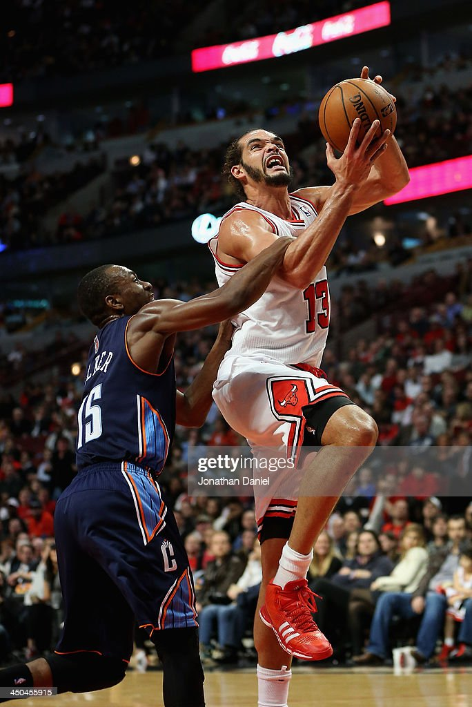 <a gi-track='captionPersonalityLinkClicked' href=/galleries/search?phrase=Joakim+Noah&family=editorial&specificpeople=699038 ng-click='$event.stopPropagation()'>Joakim Noah</a> #13 of the Chicago Bulls is fouled by <a gi-track='captionPersonalityLinkClicked' href=/galleries/search?phrase=Kemba+Walker&family=editorial&specificpeople=5042442 ng-click='$event.stopPropagation()'>Kemba Walker</a> #15 of the Charlotte Bobcats at the United Center on November 18, 2013 in Chicago, Illinois. The Bulls defeated the Bobcats 86-81.