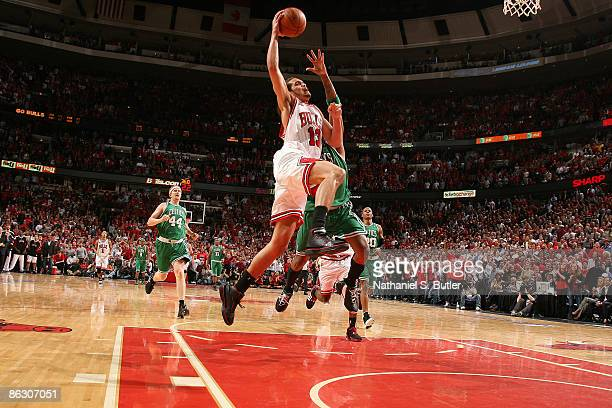 Joakim Noah of the Chicago Bulls is fouled by Paul Pierce of the Boston Celtics after stealing the ball in the third overtime of Game Six of the...