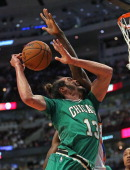 Joakim Noah of the Chicago Bulls is fouled by Serge Ibaka of the Oklahoma City Thunder at the United Center on March 17 2014 in Chicago Illinois The...
