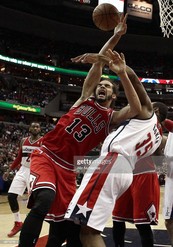 <a gi-track='captionPersonalityLinkClicked' href=/galleries/search?phrase=Joakim+Noah&family=editorial&specificpeople=699038 ng-click='$event.stopPropagation()'>Joakim Noah</a> #13 of the Chicago Bulls is fouled by <a gi-track='captionPersonalityLinkClicked' href=/galleries/search?phrase=Trevor+Booker&family=editorial&specificpeople=4123563 ng-click='$event.stopPropagation()'>Trevor Booker</a> #35 of the Washington Wizards in Game Four of the Eastern Conference Quarterfinals during the 2014 NBA Playoffs at the Verizon Center on April 27, 2014 in Washington, DC. Washington won the game 98-89.