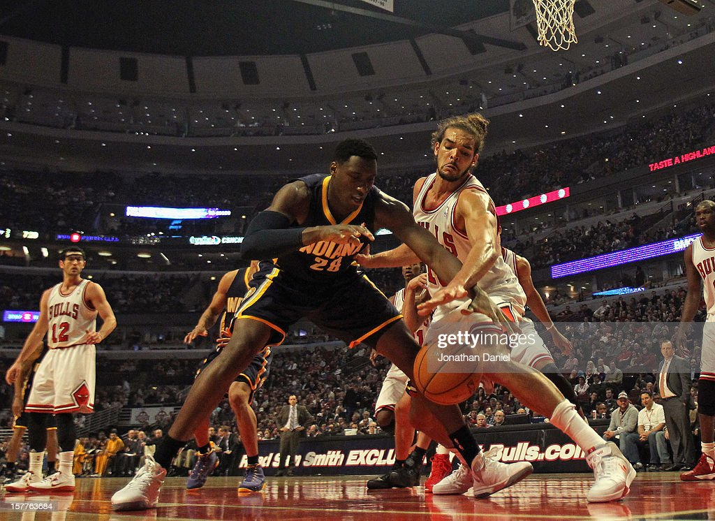 <a gi-track='captionPersonalityLinkClicked' href=/galleries/search?phrase=Joakim+Noah&family=editorial&specificpeople=699038 ng-click='$event.stopPropagation()'>Joakim Noah</a> #13 of the Chicago Bulls knocks the ball away from <a gi-track='captionPersonalityLinkClicked' href=/galleries/search?phrase=Ian+Mahinmi&family=editorial&specificpeople=740196 ng-click='$event.stopPropagation()'>Ian Mahinmi</a> #28 of the Indiana Pacers at the United Center on December 4, 2012 in Chicago, Illinois. The Pacers defeated the Bulls 80-76.