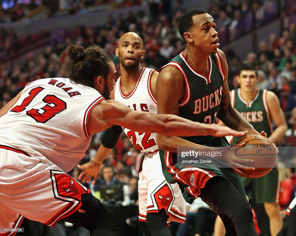 Joakim Noah #13 of the Chicago Bulls knocks the ball away from Khris Middleton #22 of the Milwaukee Bucks during the first round of the 2015 NBA Playoffs at the United Center on April 27, 2015 in Chicago, Illinois.