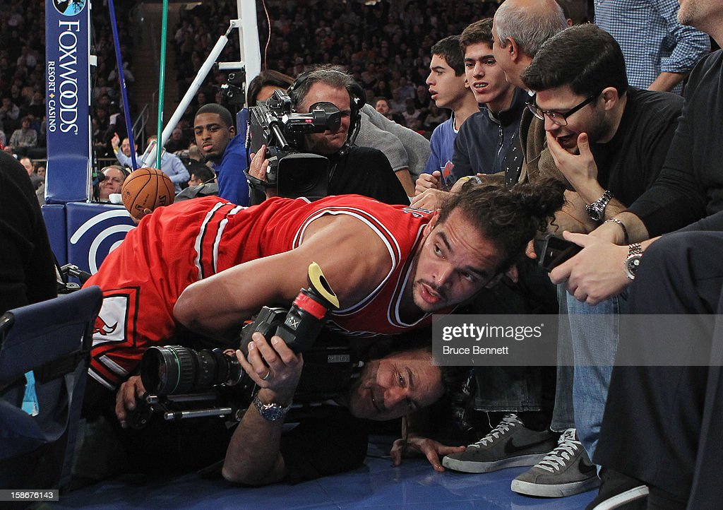 <a gi-track='captionPersonalityLinkClicked' href=/galleries/search?phrase=Joakim+Noah&family=editorial&specificpeople=699038 ng-click='$event.stopPropagation()'>Joakim Noah</a> #13 of the Chicago Bulls lands on a TV camerman as actor Jerry Ferrera of Entourage (R) looks on during the second quarter against the New York Knicks at Madison Square Garden on December 21, 2012 in New York City.