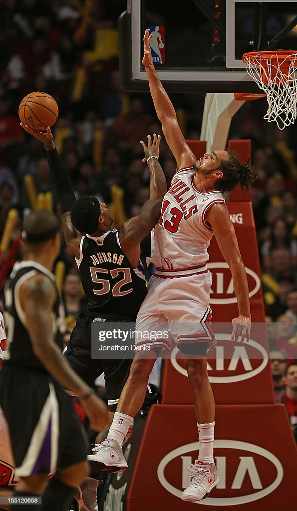 Joakim Noah #13 of the Chicago Bulls leaps to block a shot by James Johnson #52 of the Sacramento Kings at the United Center on October 31, 2012 in Chicago, Illinois. The Bulls defeated the Kings 93-87.