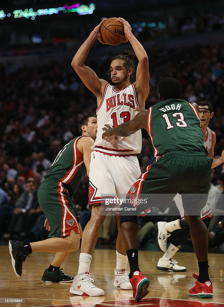 <a gi-track='captionPersonalityLinkClicked' href=/galleries/search?phrase=Joakim+Noah&family=editorial&specificpeople=699038 ng-click='$event.stopPropagation()'>Joakim Noah</a> #13 of the Chicago Bulls looks to pass between <a gi-track='captionPersonalityLinkClicked' href=/galleries/search?phrase=Beno+Udrih&family=editorial&specificpeople=202616 ng-click='$event.stopPropagation()'>Beno Udrih</a> #19 and <a gi-track='captionPersonalityLinkClicked' href=/galleries/search?phrase=Ekpe+Udoh&family=editorial&specificpeople=4185351 ng-click='$event.stopPropagation()'>Ekpe Udoh</a> #13 of the Milwaukee Bucks at the United Center on November 26, 2012 in Chicago, Illinois. The Bucks defeated the Bulls 93-92.