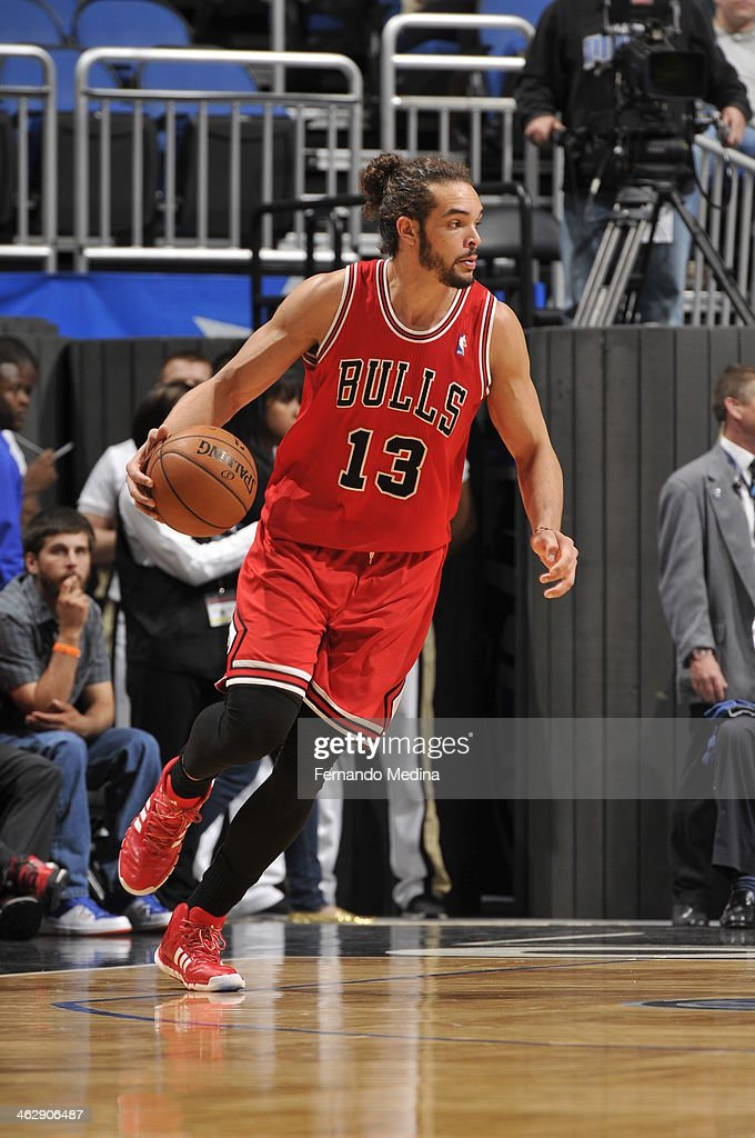 Joakim Noah #13 of the Chicago Bulls looks to pass the ball against the Orlando Magic during the game on January 15, 2014 at Amway Center in Orlando, Florida.