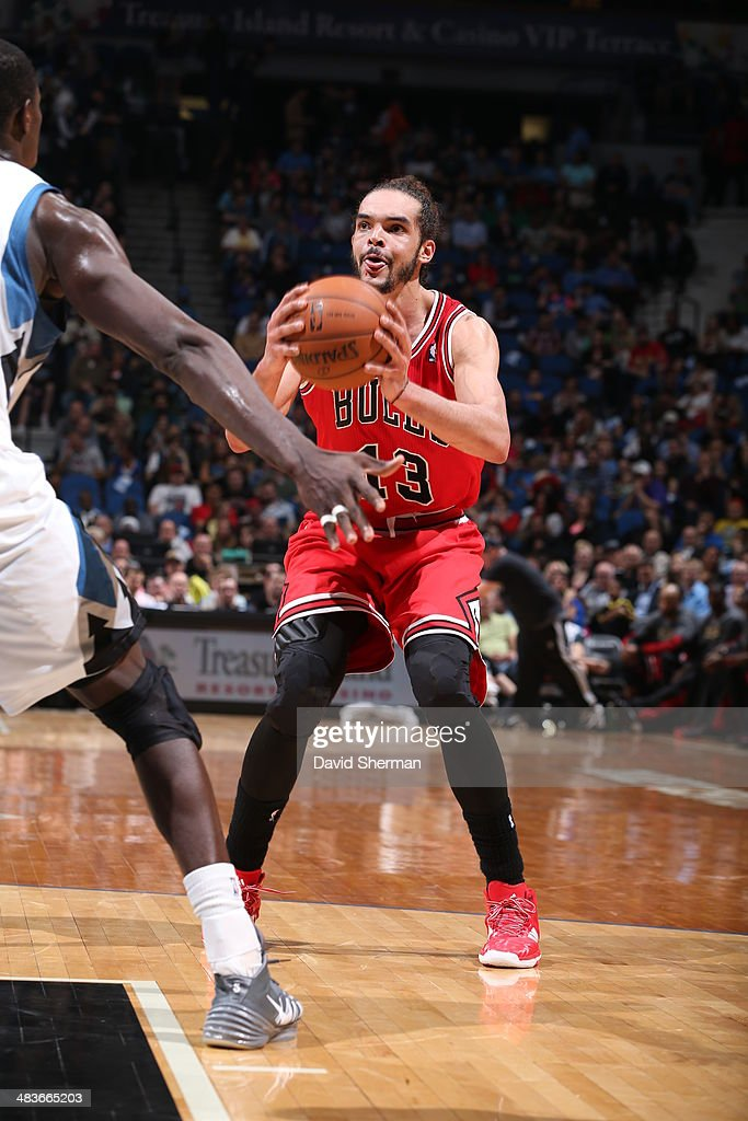 Joakim Noah #13 of the Chicago Bulls looks to pass the ball against the Minnesota Timberwolves during the game on April 9, 2014 at Target Center in Minneapolis, Minnesota.