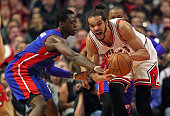 Joakim Noah of the Chicago Bulls looks to pass under pressure from Reggie Jackson of the Detroit Pistons at the United Center on April 3 2015 in...