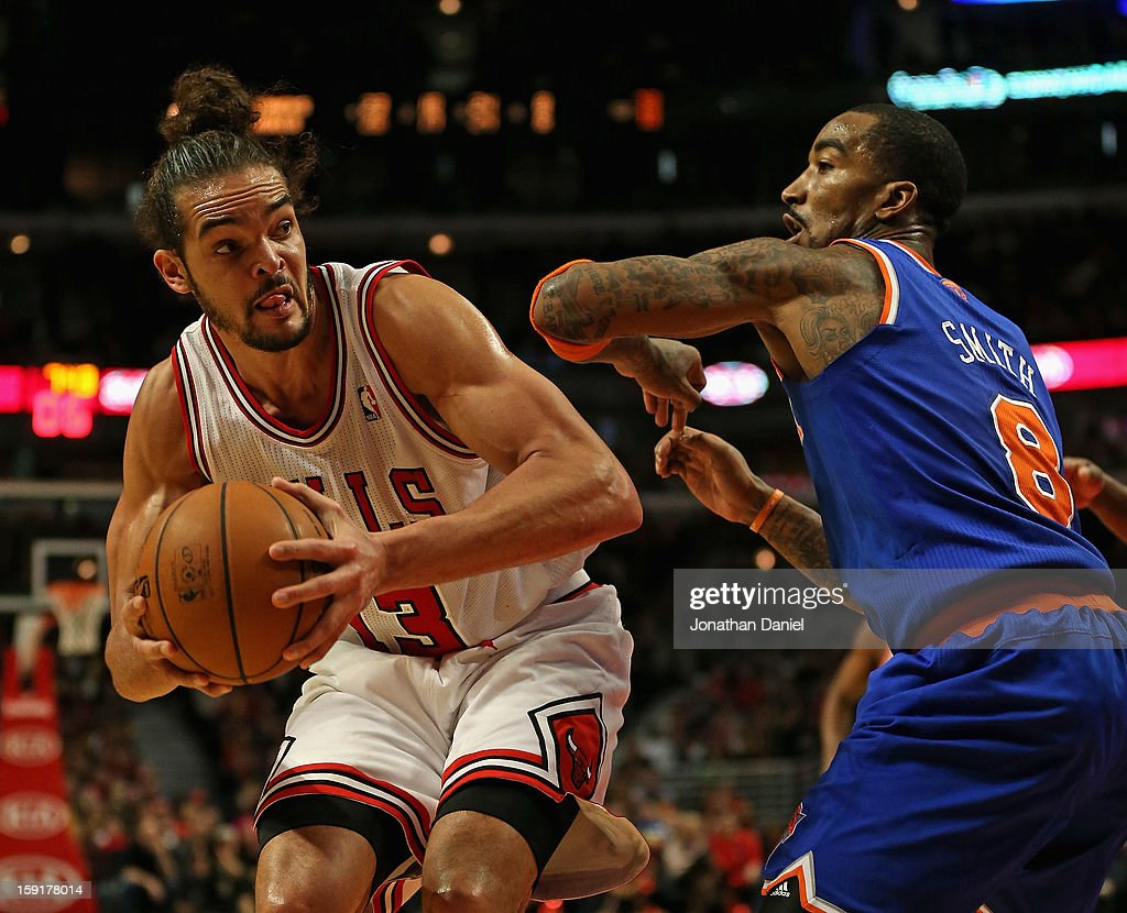 <a gi-track='captionPersonalityLinkClicked' href=/galleries/search?phrase=Joakim+Noah&family=editorial&specificpeople=699038 ng-click='$event.stopPropagation()'>Joakim Noah</a> #13 of the Chicago Bulls moves against <a gi-track='captionPersonalityLinkClicked' href=/galleries/search?phrase=J.R.+Smith&family=editorial&specificpeople=201766 ng-click='$event.stopPropagation()'>J.R. Smith</a> #8 of the New York Knicks at the United Center on December 8, 2012 in Chicago, Illinois. The Bulls defeated the Knicks 93-85.