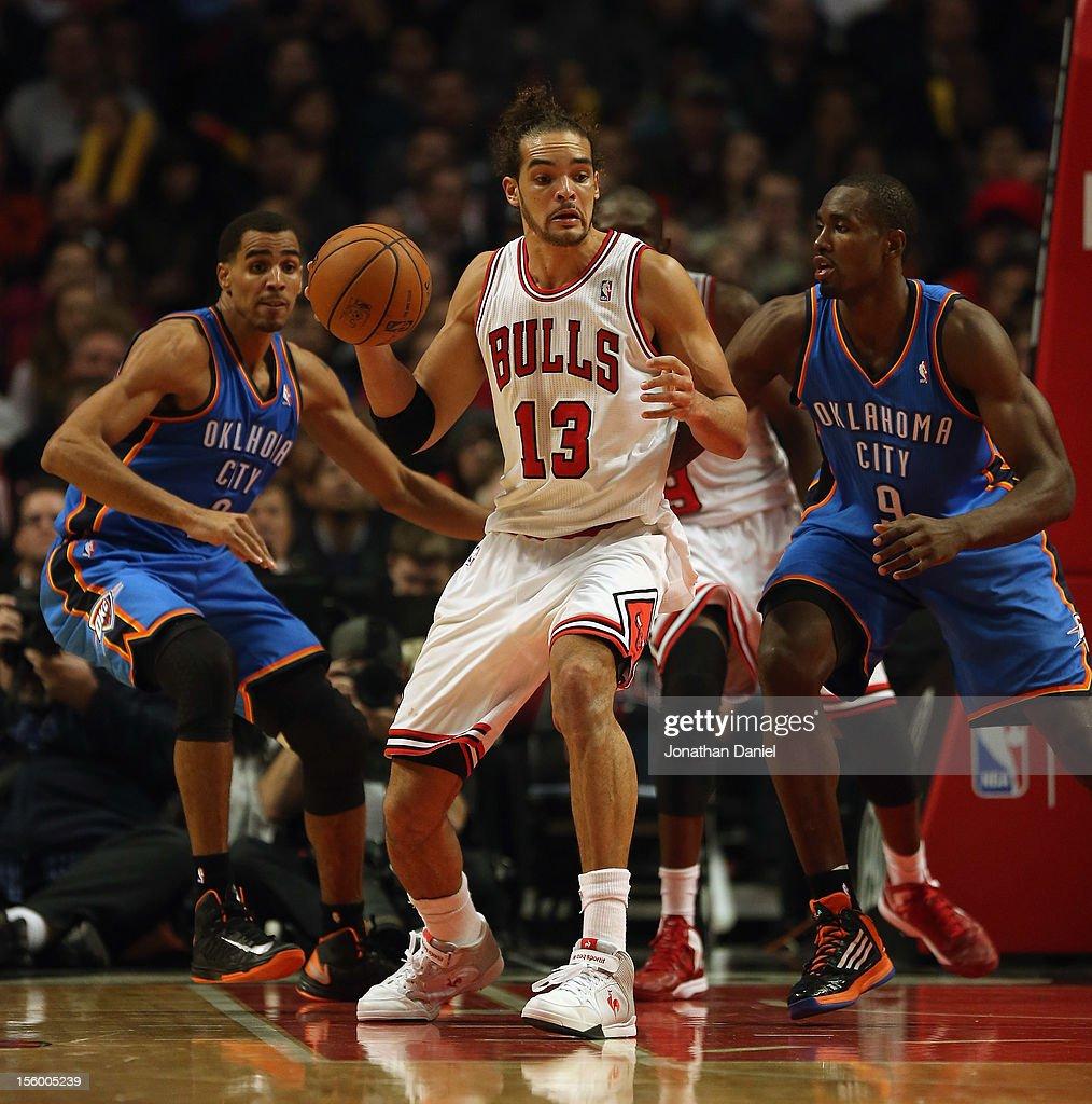 Joakim Noah #13 of the Chicago Bulls moves against Thabo Sefolosha #2 and Serge Ibaka #9 of the Oklahoma City Thunder at the United Center on November 8, 2012 in Chicago, Illinois. The Thunder defeated the Bulls 97-91.
