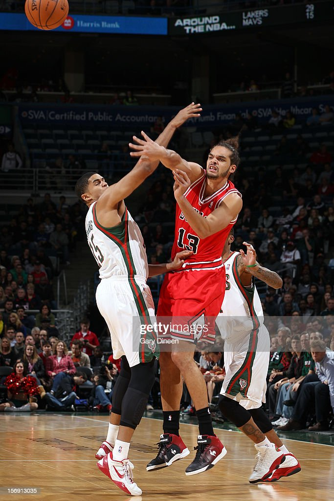 Joakim Noah #13 of the Chicago Bulls passes against Tobias Harris #15 of the Milwaukee Bucks during the game on November 24, 2012 at the BMO Harris Bradley Center in Milwaukee, Wisconsin.
