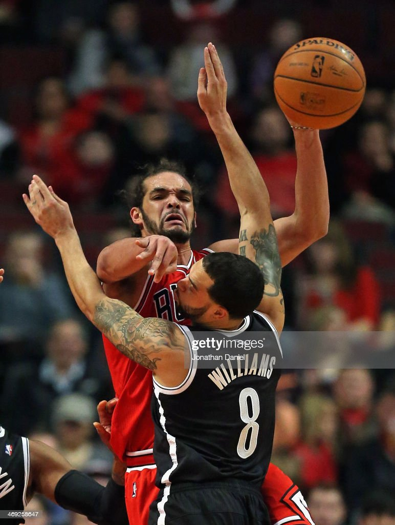 <a gi-track='captionPersonalityLinkClicked' href=/galleries/search?phrase=Joakim+Noah&family=editorial&specificpeople=699038 ng-click='$event.stopPropagation()'>Joakim Noah</a> #13 of the Chicago Bulls passes over <a gi-track='captionPersonalityLinkClicked' href=/galleries/search?phrase=Deron+Williams&family=editorial&specificpeople=203215 ng-click='$event.stopPropagation()'>Deron Williams</a> #8 of the Brooklyn Nets at the United Center on February 13, 2014 in Chicago, Illinois.