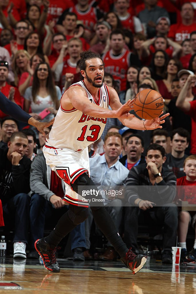 <a gi-track='captionPersonalityLinkClicked' href=/galleries/search?phrase=Joakim+Noah&family=editorial&specificpeople=699038 ng-click='$event.stopPropagation()'>Joakim Noah</a> #13 of the Chicago Bulls passes the ball against the Washington Wizards during Game 1 of the Eastern Conference Quarterfinals on April 20, 2014 at the United Center in Chicago, Illinois.