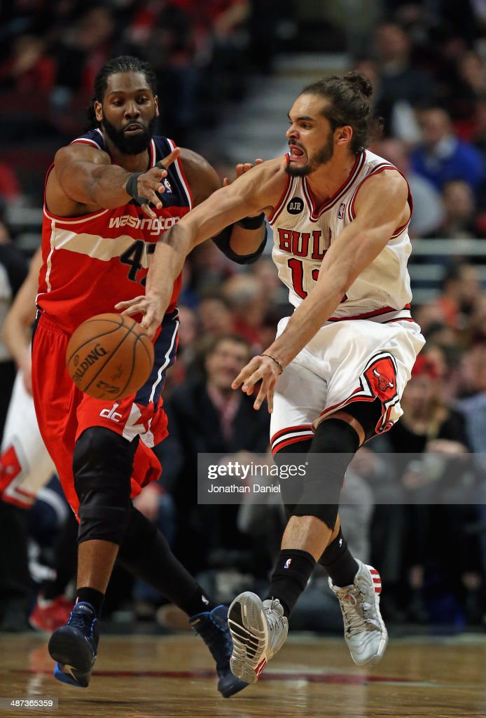 <a gi-track='captionPersonalityLinkClicked' href=/galleries/search?phrase=Joakim+Noah&family=editorial&specificpeople=699038 ng-click='$event.stopPropagation()'>Joakim Noah</a> #13 of the Chicago Bulls passes under pressure from Nene #42 of the Washington Wizards in Game Five of the Eastern Conference Quarterfinals during the 2014 NBA Playoffs at the United Center on April 29, 2014 in Chicago, Illinois.