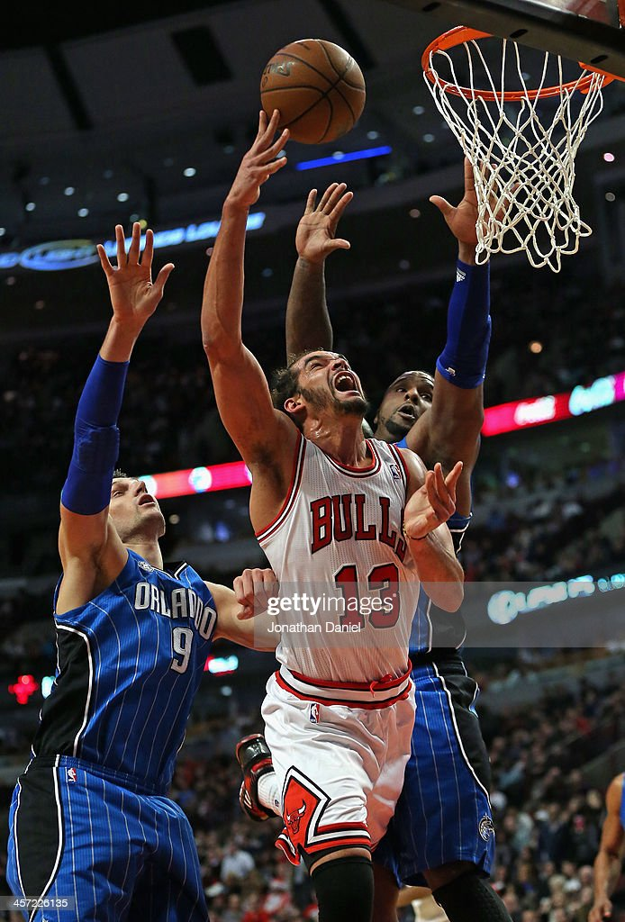 <a gi-track='captionPersonalityLinkClicked' href=/galleries/search?phrase=Joakim+Noah&family=editorial&specificpeople=699038 ng-click='$event.stopPropagation()'>Joakim Noah</a> #13 of the Chicago Bulls puts up a shot between Nikola Vucevic #9 and Glen Davis #11 of the Orlando Magic at the United Center on December 16, 2013 in Chicago, Illinois. The Magic defeated the Bulls 83-82.