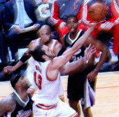 Joakim Noah of the Chicago Bulls puts up a shot past DeMarcus Cousins of the Sacramento Kings as Taj Gibson and Jason Thompson watch the action at...