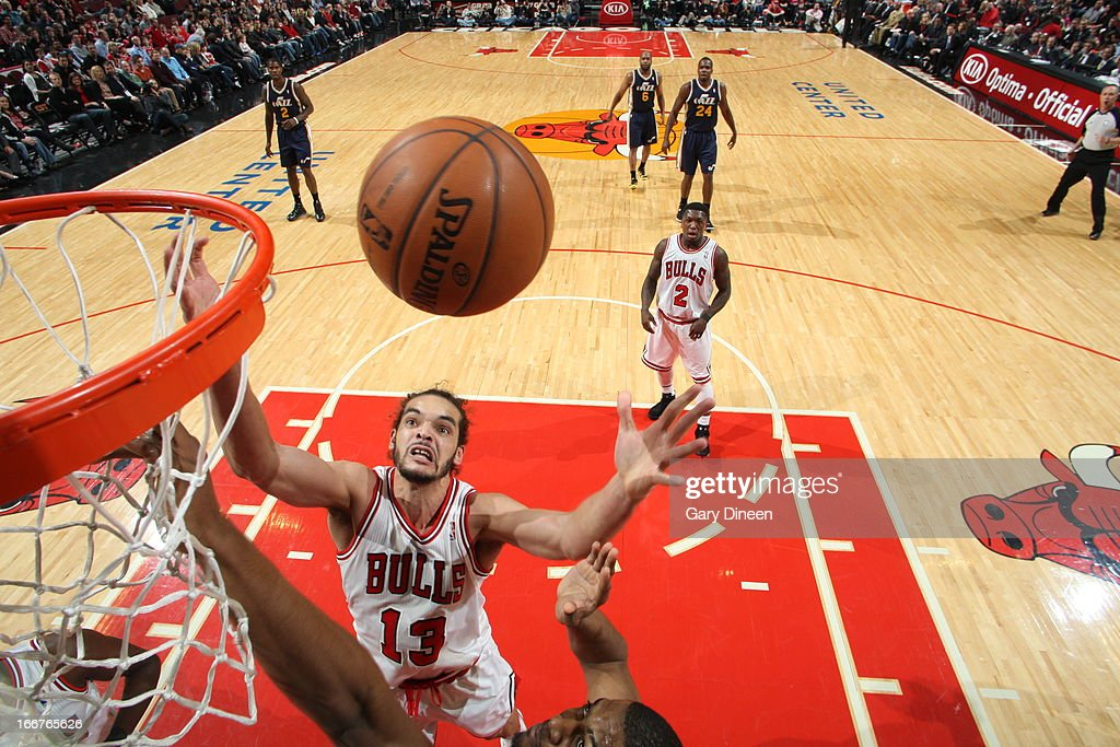 <a gi-track='captionPersonalityLinkClicked' href=/galleries/search?phrase=Joakim+Noah&family=editorial&specificpeople=699038 ng-click='$event.stopPropagation()'>Joakim Noah</a> #13 of the Chicago Bulls reaches for a rebound against the Utah Jazz on March 08, 2013 at the United Center in Chicago, Illinois.