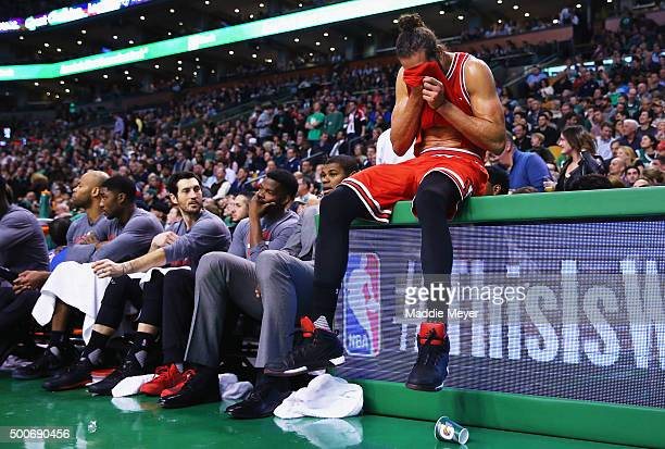 Joakim Noah of the Chicago Bulls reacts next to the bench during the fourth quarter against the Boston Celtics at TD Garden on December 9 2015 in...