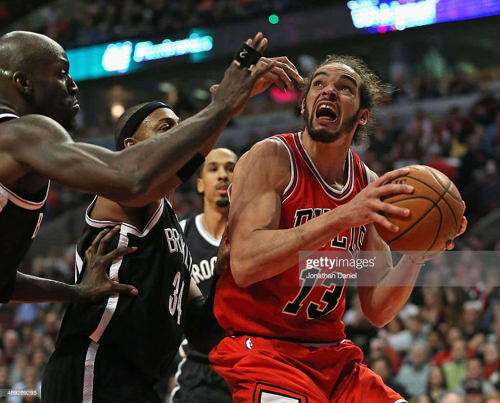 Joakim Noah #13 of the Chicago Bulls readies to shoot against Kevin Garnett #2 and Paul Pierce #34 of the Brooklyn Nets at the United Center on February 13, 2014 in Chicago, Illinois. The Bulls defeated the Nets 92-76.