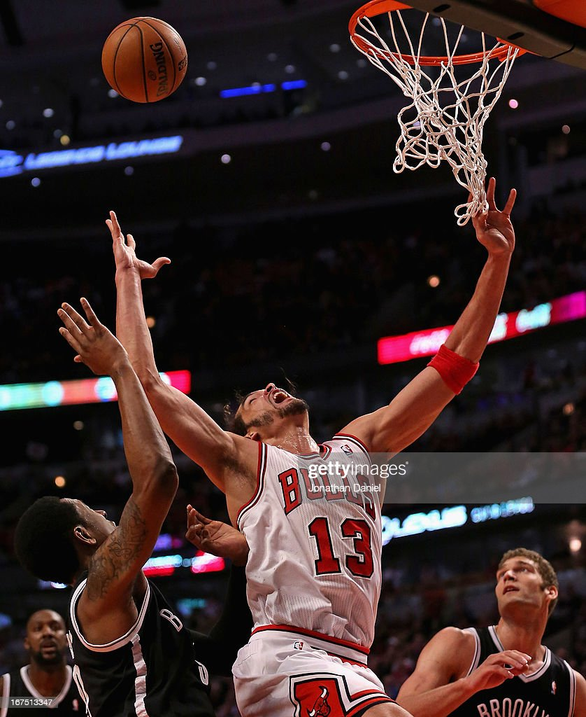 <a gi-track='captionPersonalityLinkClicked' href=/galleries/search?phrase=Joakim+Noah&family=editorial&specificpeople=699038 ng-click='$event.stopPropagation()'>Joakim Noah</a> #13 of the Chicago Bulls rebounds against the Brooklyn Nets in Game Three of the Eastern Conference Quarterfinals during the 2013 NBA Playoffs at the United Center on April 25, 2013 in Chicago, Illinois. The Bulls defeated the Nets 79-76.