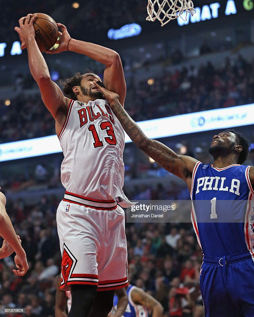 Joakim Noah of the Chicago Bulls rebounds as Tony Wroten of the Philadelphia 76ers gets his hand in his face at the United Center on December 14 2015...