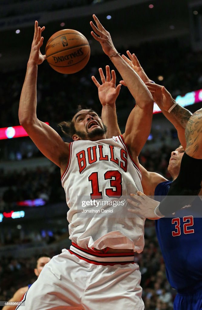 <a gi-track='captionPersonalityLinkClicked' href=/galleries/search?phrase=Joakim+Noah&family=editorial&specificpeople=699038 ng-click='$event.stopPropagation()'>Joakim Noah</a> #13 of the Chicago Bulls rebounds over <a gi-track='captionPersonalityLinkClicked' href=/galleries/search?phrase=Blake+Griffin+-+Basketball+Player&family=editorial&specificpeople=4216010 ng-click='$event.stopPropagation()'>Blake Griffin</a> #32 of the Los Angeles Clippers at the United Center on January 24, 2014 in Chicago, Illinois. The Clippers defeated the Bulls 112-95.