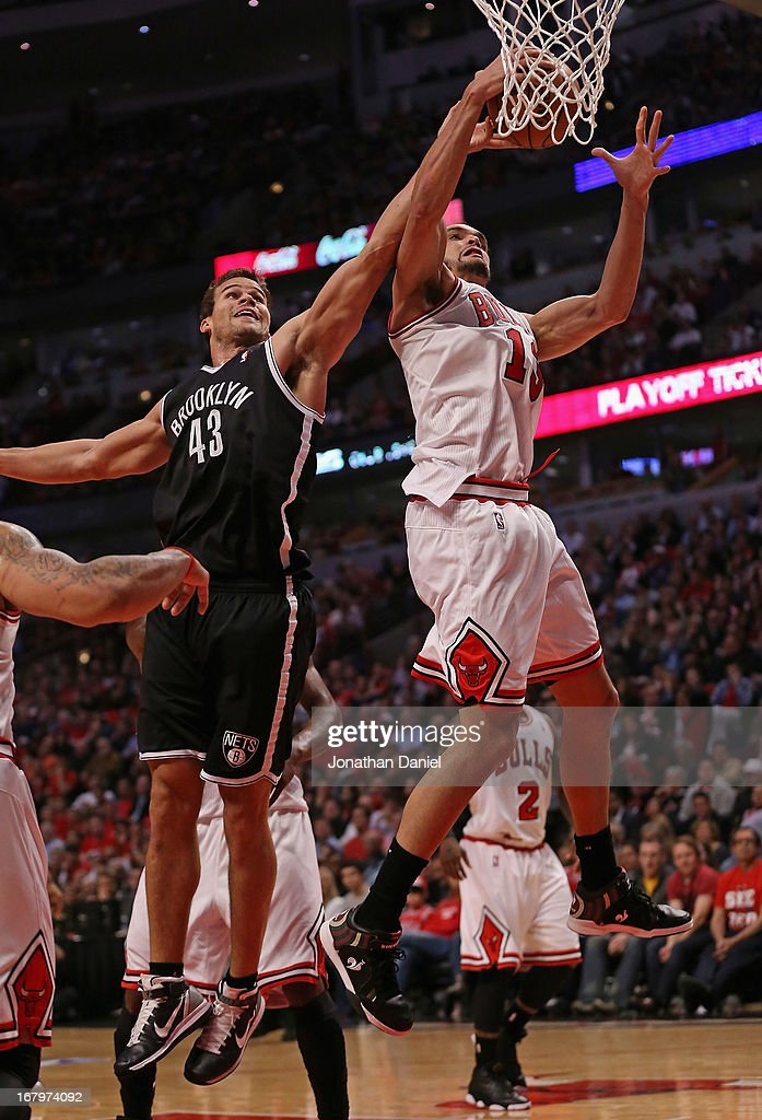 Joakim Noah #13 of the Chicago Bulls rebounds over Kris Humphries #43 of the Brooklyn Nets in Game Six of the Eastern Conference Quarterfinals during the 2013 NBA Playoffs at the United Center on May 2, 2013 in Chicago, Illinois. The Nets defeated the Bulls 95-92.