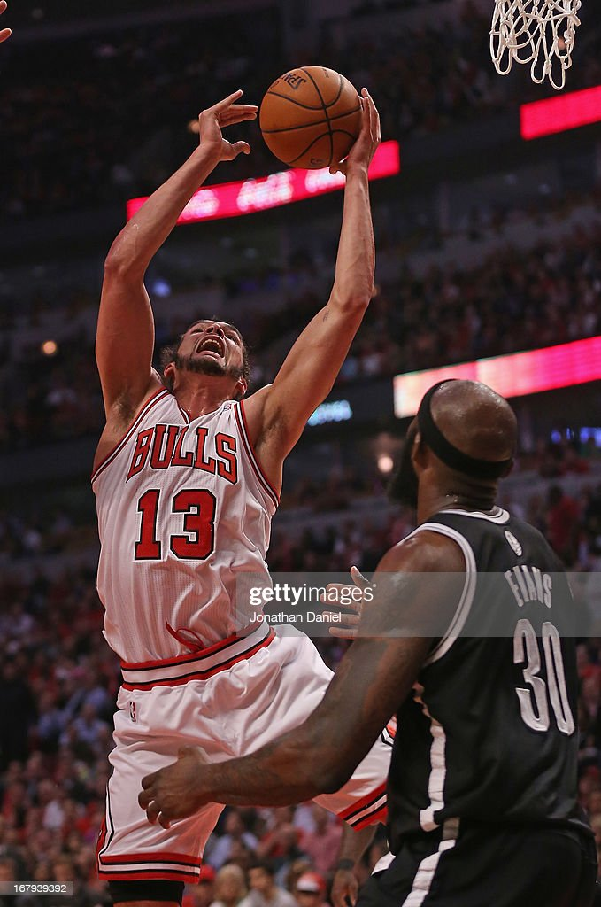 Joakim Noah #13 of the Chicago Bulls rebounds over Reggie Evans #30 of the Brooklyn Nets in Game Six of the Eastern Conference Quarterfinals during the 2013 NBA Playoffs at the United Center on May 2, 2013 in Chicago, Illinois.