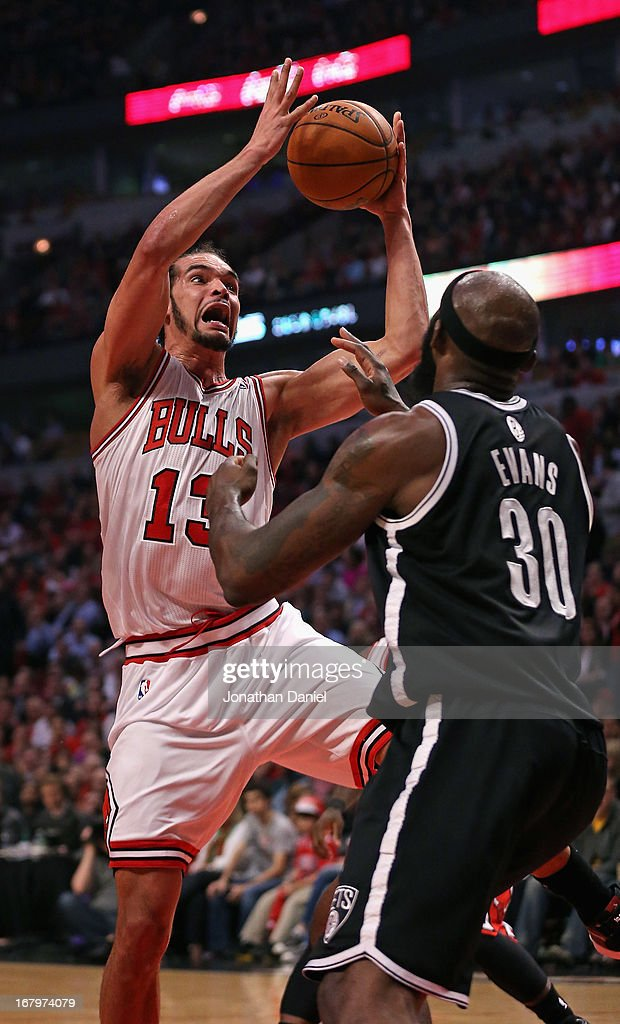 Joakim Noah #13 of the Chicago Bulls rebounds over Reggie Evans #30 of the Brooklyn Nets in Game Six of the Eastern Conference Quarterfinals during the 2013 NBA Playoffs at the United Center on May 2, 2013 in Chicago, Illinois. The Nets defeated the Bulls 95-92.