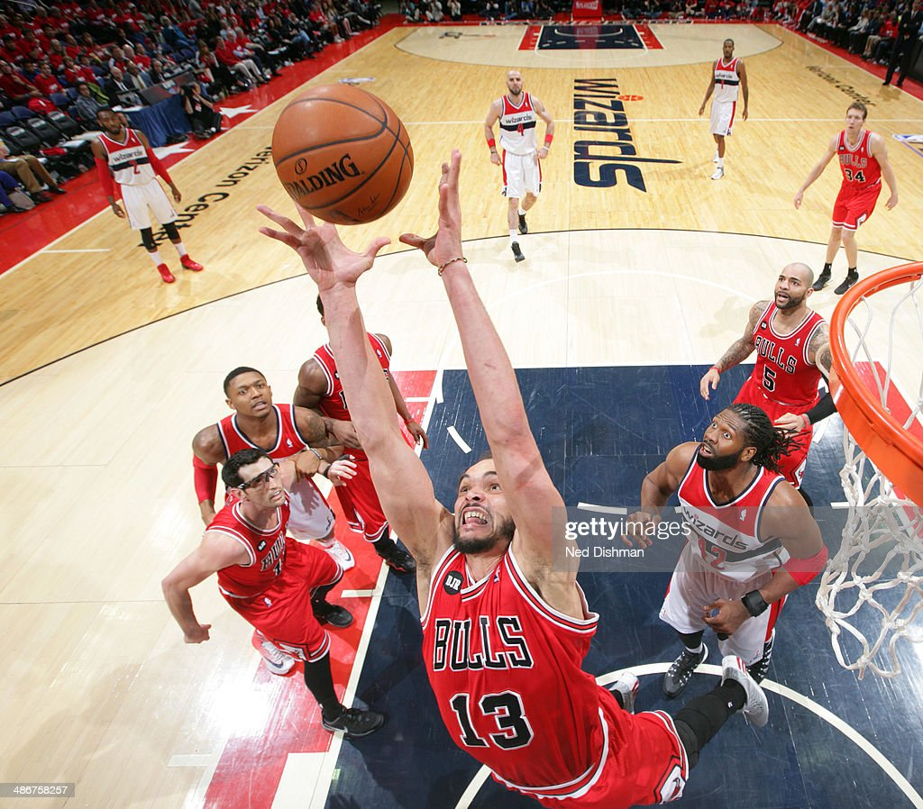 Joakim Noah #13 of the Chicago Bulls rebounds the ball against the Washington Wizards in Game Three of the Eastern Conference Quarterfinals during the 2014 NBA Playoffs at the Verizon Center on April 25, 2014 in Washington, DC.
