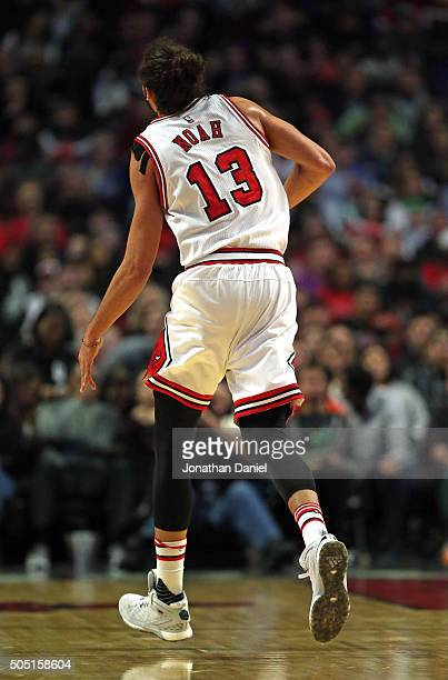 Joakim Noah of the Chicago Bulls runs off of the court after dislocating his left shoulder against the Dallas Mavericks at the United Center on...