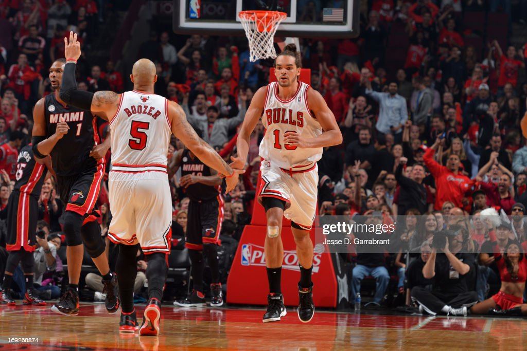 <a gi-track='captionPersonalityLinkClicked' href=/galleries/search?phrase=Joakim+Noah&family=editorial&specificpeople=699038 ng-click='$event.stopPropagation()'>Joakim Noah</a> #13 of the Chicago Bulls runs up court during the game against the Miami Heat in Game Three of the Eastern Conference Quarterfinals during the 2013 NBA Playoffs on May 10, 2013 at United Center in Chicago, Illinois.