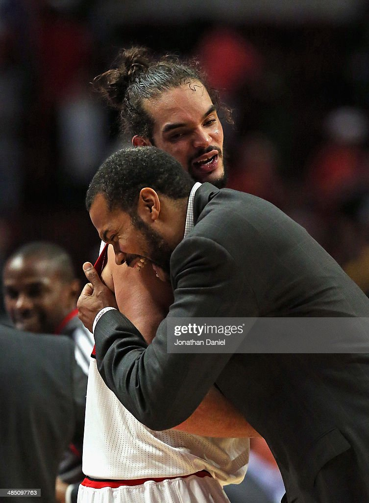 Joakim Noah #13 of the Chicago Bulls shares a laugh coach Rasheed Wallace of the Detroit Pistons at the United Center on April 11, 2014 in Chicago, Illinois. The Bulls defeated the Pistons 106-98.