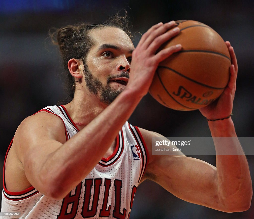 Joakim Noah #13 of the Chicago Bulls shoots a free throw against the Detroit Pistons at the United Center on April 11, 2014 in Chicago, Illinois. The Bulls defeated the Pistons 106-98.