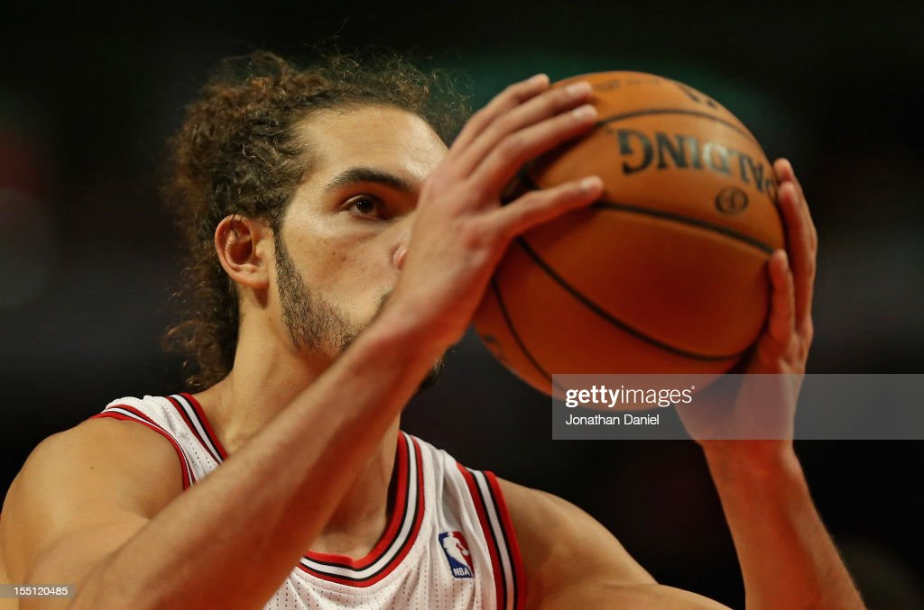 Joakim Noah #13 of the Chicago Bulls shoots a free-throw on his way to a game-high 23 points against the Sacramento Kings at the United Center on October 31, 2012 in Chicago, Illinois. The Bulls defeated the Kings 93-87.