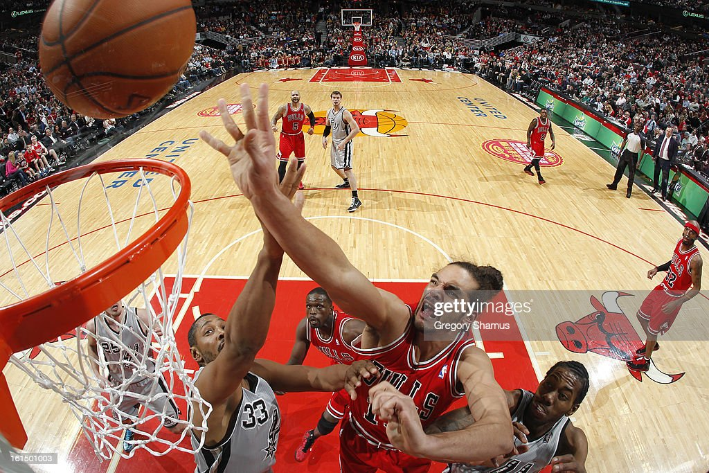 <a gi-track='captionPersonalityLinkClicked' href=/galleries/search?phrase=Joakim+Noah&family=editorial&specificpeople=699038 ng-click='$event.stopPropagation()'>Joakim Noah</a> #13 of the Chicago Bulls shoots a layup against <a gi-track='captionPersonalityLinkClicked' href=/galleries/search?phrase=Boris+Diaw&family=editorial&specificpeople=201505 ng-click='$event.stopPropagation()'>Boris Diaw</a> #33 and Kawhl Leonard #2 of the San Antonio Spurs on February 11, 2013 at the United Center in Chicago, Illinois.