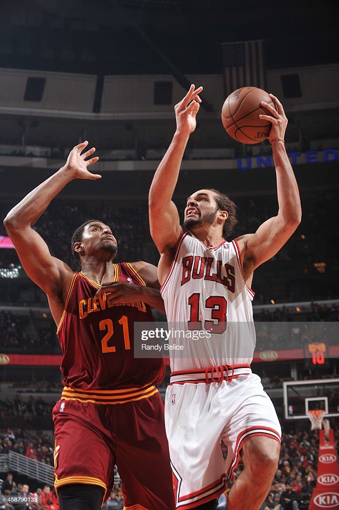 <a gi-track='captionPersonalityLinkClicked' href=/galleries/search?phrase=Joakim+Noah&family=editorial&specificpeople=699038 ng-click='$event.stopPropagation()'>Joakim Noah</a> #13 of the Chicago Bulls shoots against <a gi-track='captionPersonalityLinkClicked' href=/galleries/search?phrase=Andrew+Bynum&family=editorial&specificpeople=630695 ng-click='$event.stopPropagation()'>Andrew Bynum</a> #21 of the Cleveland Cavaliers on December 21, 2013 at the United Center in Chicago, Illinois.