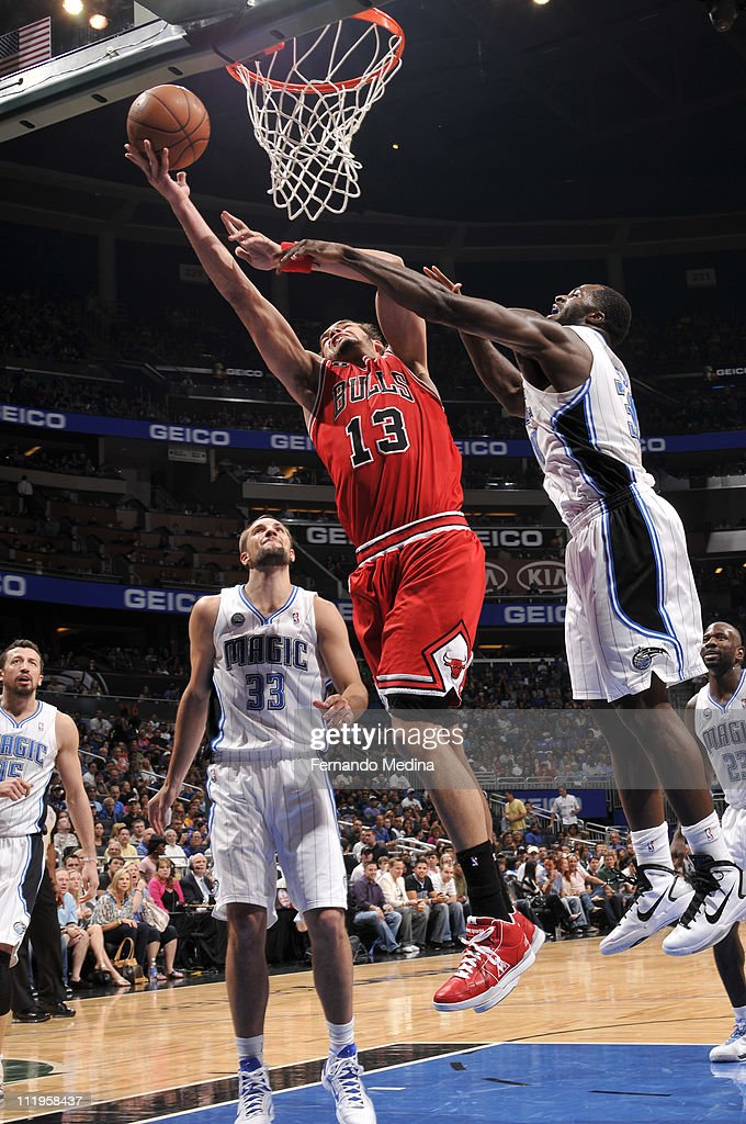 <a gi-track='captionPersonalityLinkClicked' href=/galleries/search?phrase=Joakim+Noah&family=editorial&specificpeople=699038 ng-click='$event.stopPropagation()'>Joakim Noah</a> #13 of the Chicago Bulls shoots against <a gi-track='captionPersonalityLinkClicked' href=/galleries/search?phrase=Brandon+Bass&family=editorial&specificpeople=233806 ng-click='$event.stopPropagation()'>Brandon Bass</a> #30 of the Orlando Magic on April 10, 2011 at the Amway Center in Orlando, Florida.