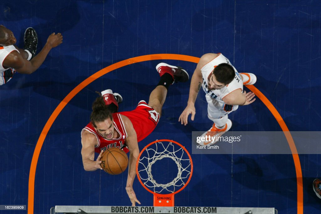 <a gi-track='captionPersonalityLinkClicked' href=/galleries/search?phrase=Joakim+Noah&family=editorial&specificpeople=699038 ng-click='$event.stopPropagation()'>Joakim Noah</a> #13 of the Chicago Bulls shoots against Byron Mullens #22 of the Charlotte Bobcats at the Time Warner Cable Arena on February 22, 2013 in Charlotte, North Carolina.