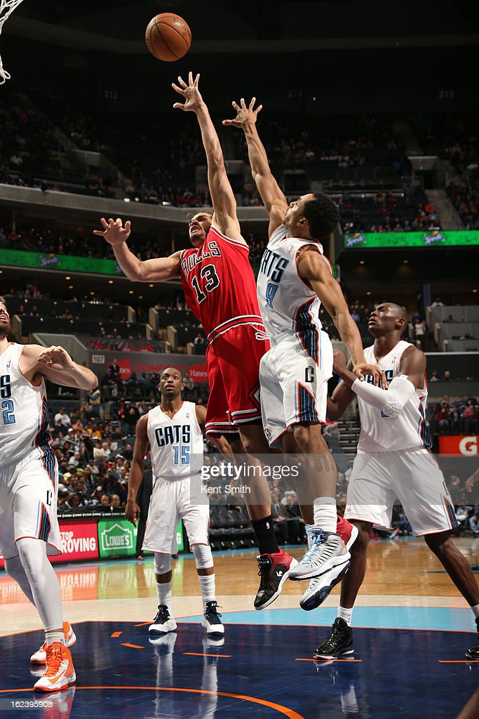 <a gi-track='captionPersonalityLinkClicked' href=/galleries/search?phrase=Joakim+Noah&family=editorial&specificpeople=699038 ng-click='$event.stopPropagation()'>Joakim Noah</a> #13 of the Chicago Bulls shoots against Gerald Henderson #9 of the Charlotte Bobcats at the Time Warner Cable Arena on February 22, 2013 in Charlotte, North Carolina.
