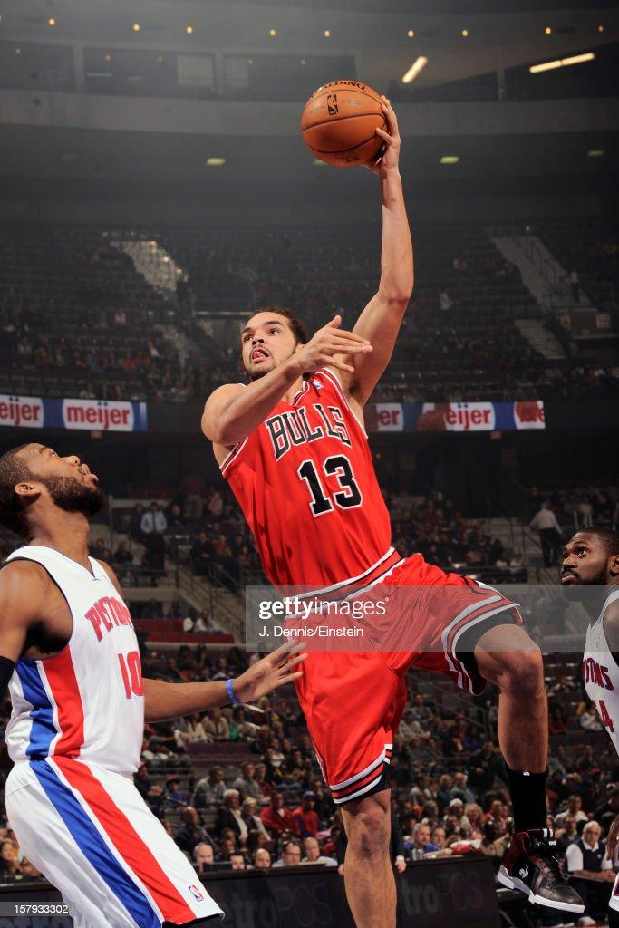 Joakim Noah #13 of the Chicago Bulls shoots against Greg Monroe #10 of the Detroit Pistons on December 7, 2012 at The Palace of Auburn Hills in Auburn Hills, Michigan.