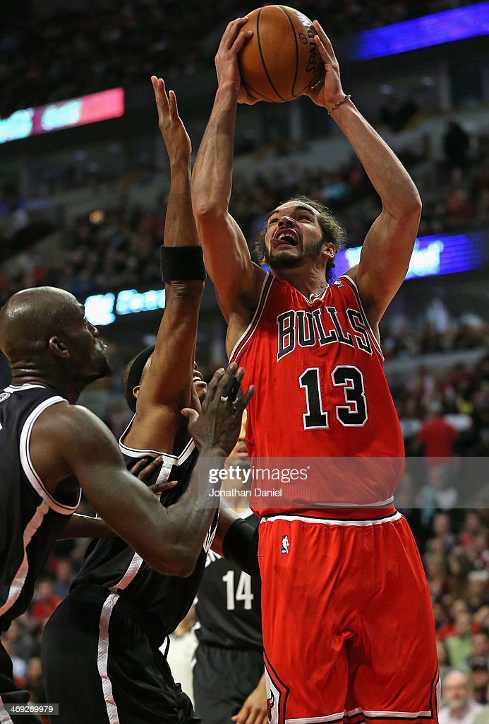 Joakim Noah #13 of the Chicago Bulls shoots against Kevin Garnett #2 and Paul Pierce #34 of the Brooklyn Nets at the United Center on February 13, 2014 in Chicago, Illinois. The Bulls defeated the Nets 92-76.