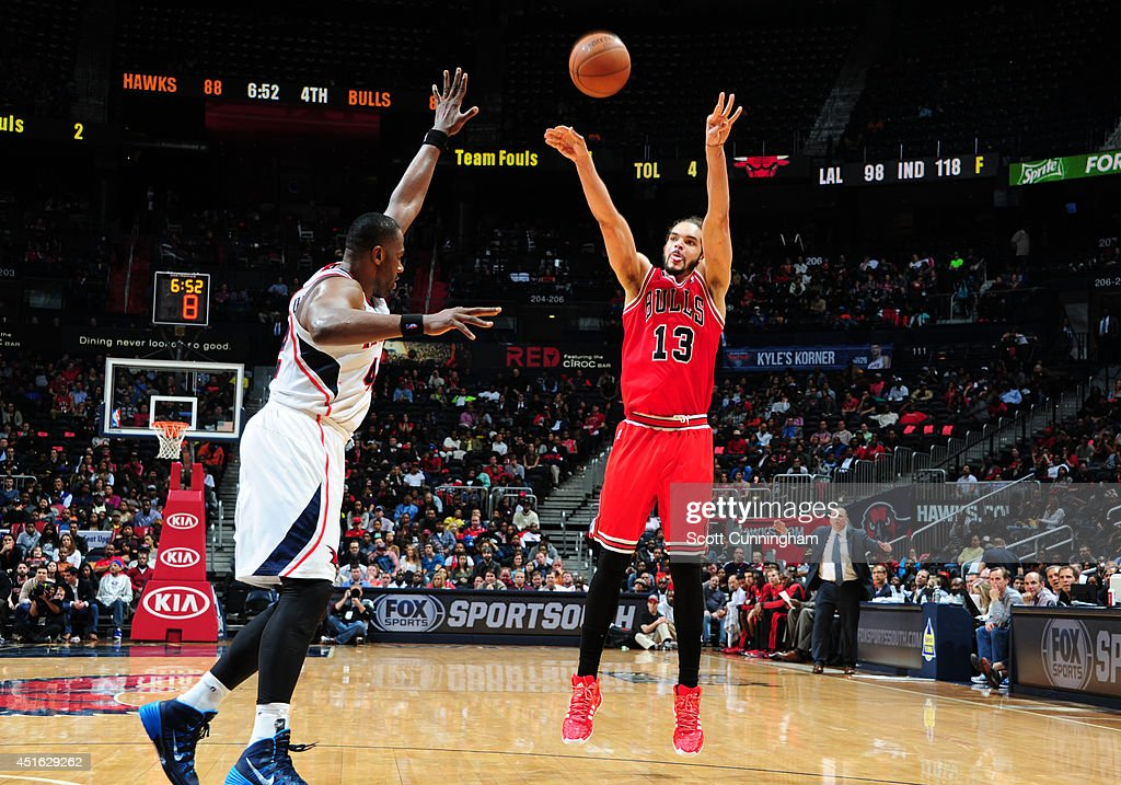 <a gi-track='captionPersonalityLinkClicked' href=/galleries/search?phrase=Joakim+Noah&family=editorial&specificpeople=699038 ng-click='$event.stopPropagation()'>Joakim Noah</a> #13 of the Chicago Bulls shoots against the Atlanta Hawks on February 25, 2014 at Philips Arena in Atlanta, Georgia.